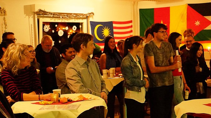 At the first international Christmas party, three of the university's highly engaged students were honored.
