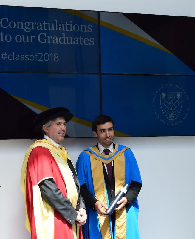 Magnificent robes: Rui Almeida (pictured right) with his doctoral supervisor Prof. David Harrison from Glasgow Caledonian University.
